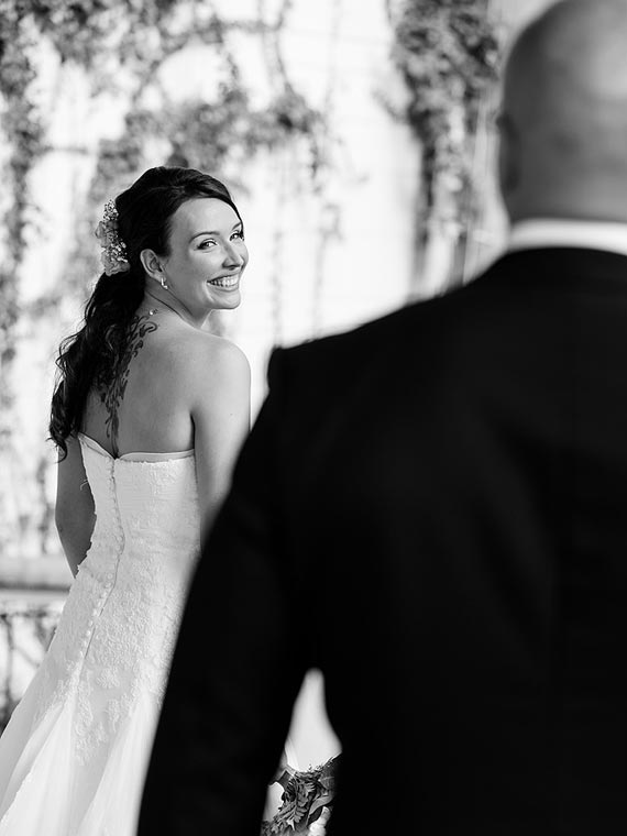 Bride glancing at the groom